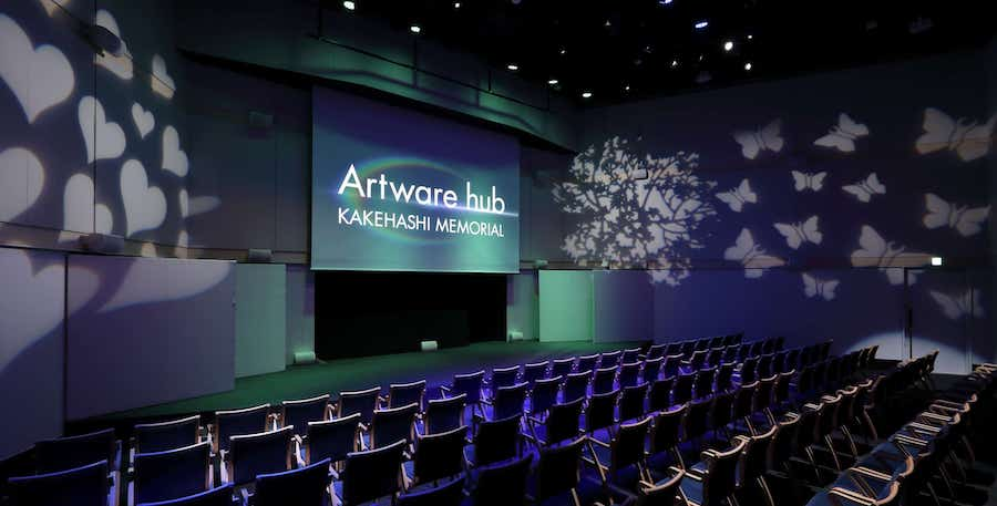 Theater with seating, projection screen and 24 in-wall speakers