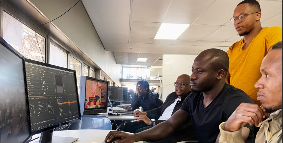 Editing team collaborates on a story at Newzroom Afrika