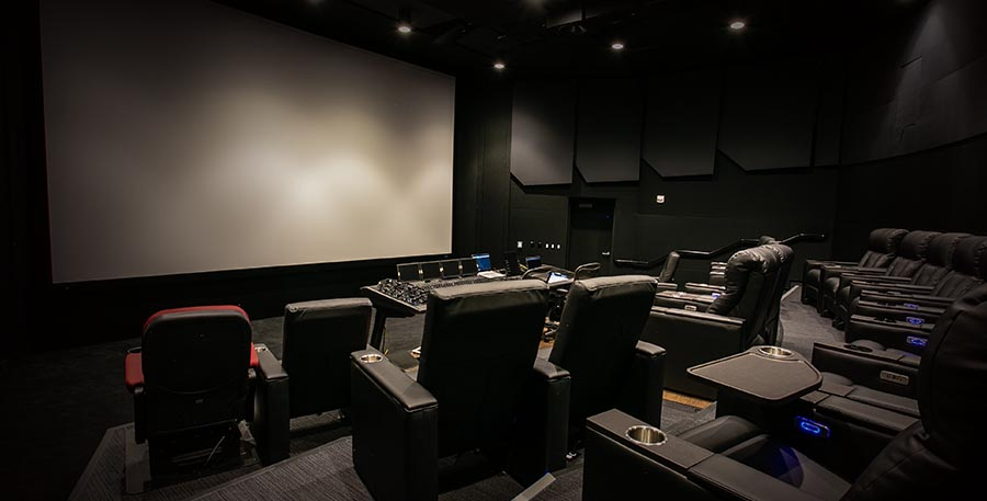 Image of expansive mixing theatre with Dolby Atmos and Pro Tools workstation