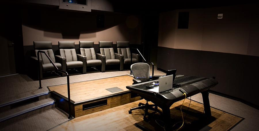 Image of small mixing room with Dolby Atmos and Pro Tools workstation