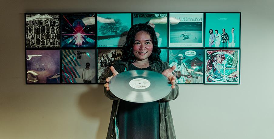mastering engineer Jett Galindo shows off her vinyl
