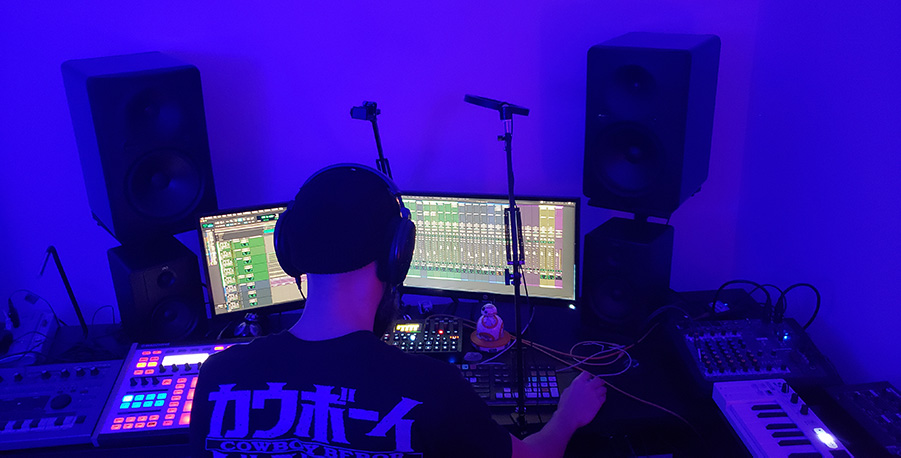 Laz Casanova mixing in a blue room