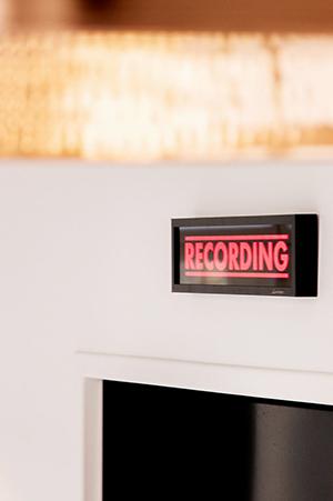 recording sign over door in Saya Post Production office