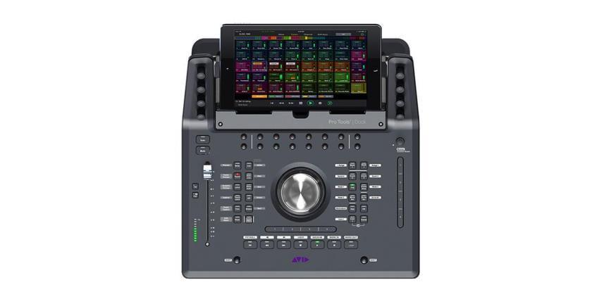 Avid Dock control surface with transport controls, jog wheel, and fader integrated with the free Avid Control app on a tablet