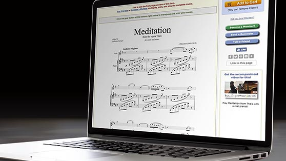 """Laptop computer showing the music score and notation for the song """"Meditation"""" on its screen"""