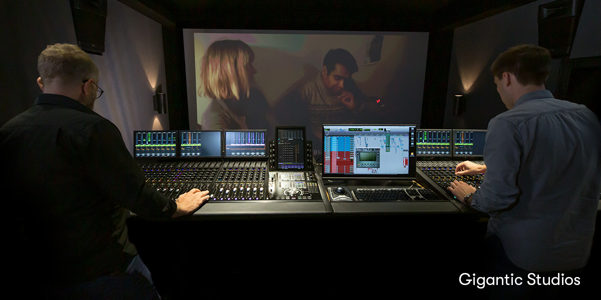 Image of two people at a Pro Tools and Dolby Atmos mixing workstation