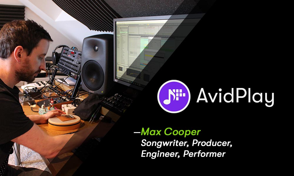 Max Cooper using computer and audio equipment