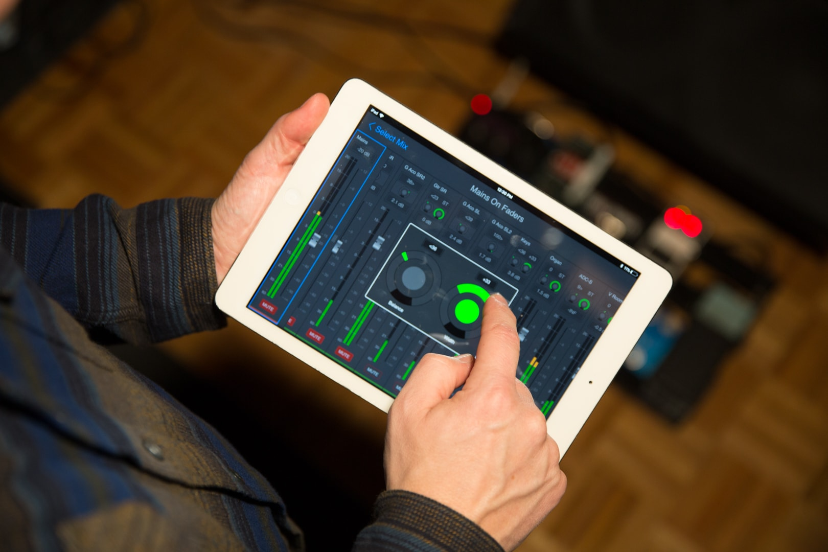 Musician using VENUE Onstage in ear monitor app to control mixes