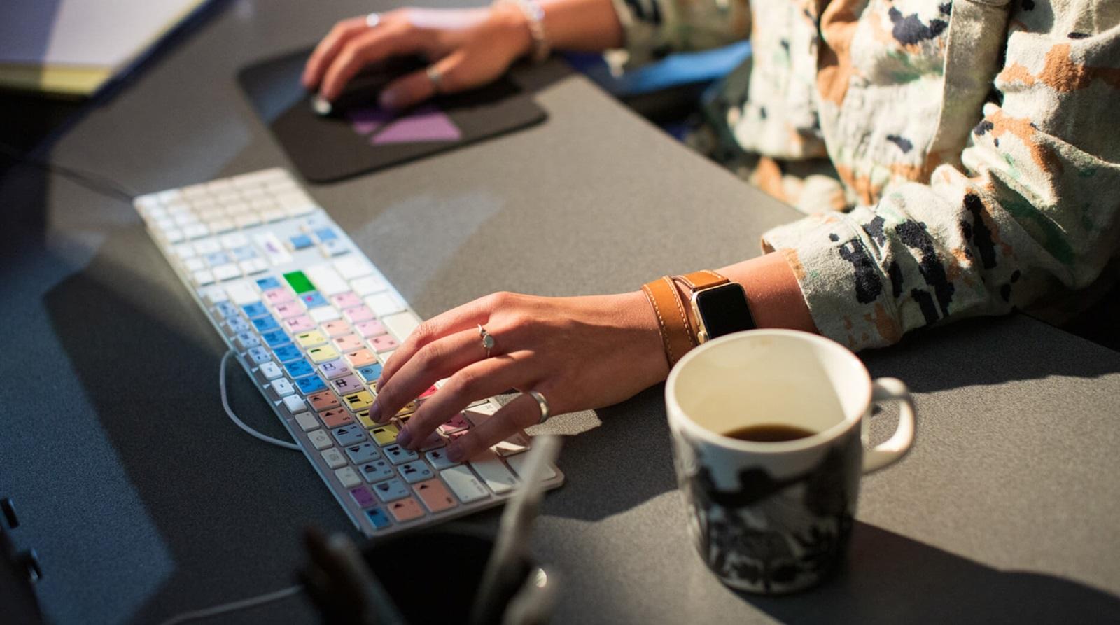 closeup editors hands on keyboard