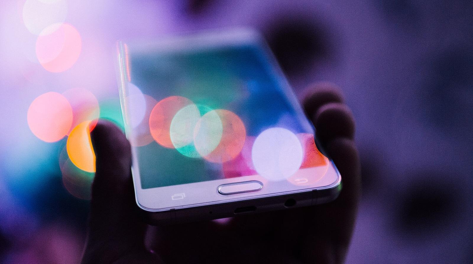 consuming digital media on a smartphone