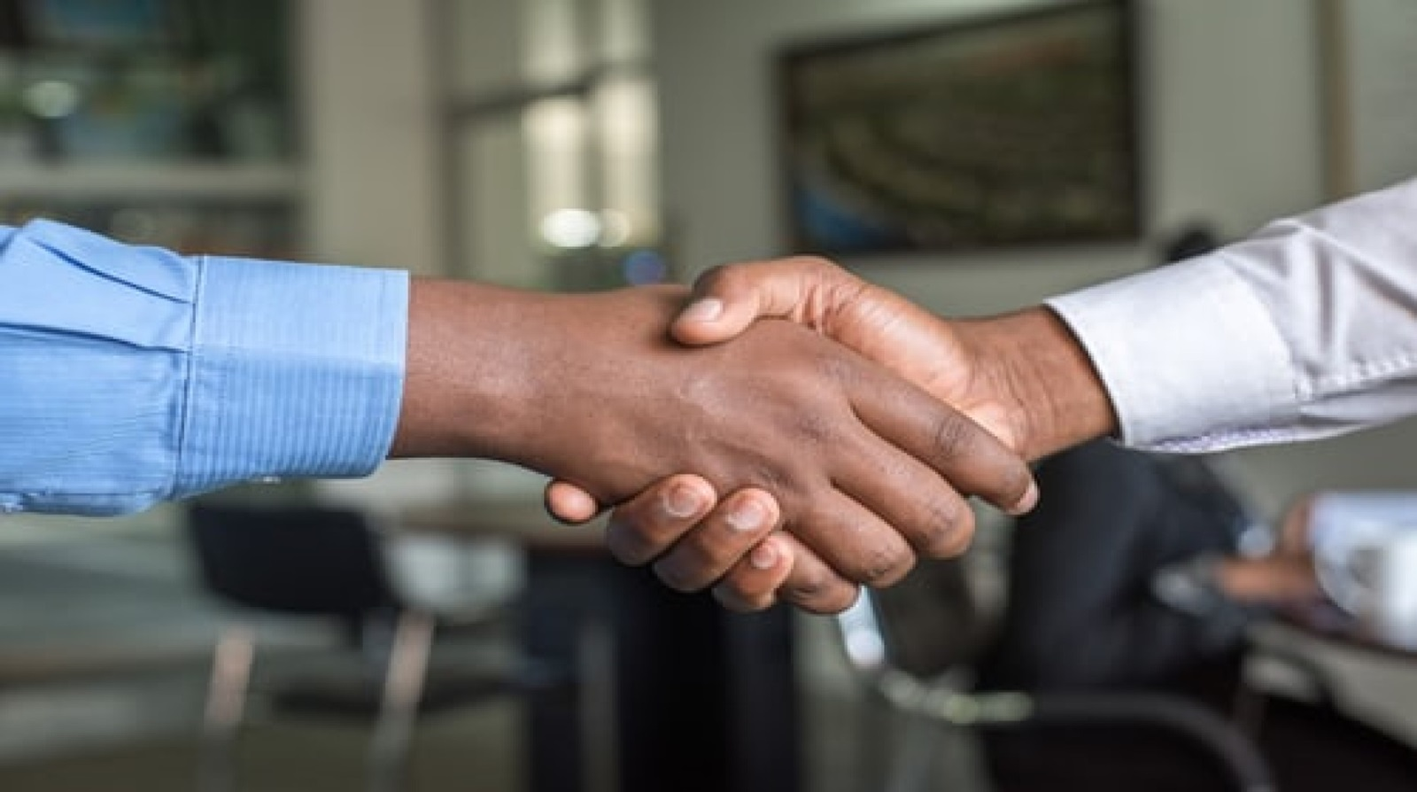 A close-up image of two people shaking hands