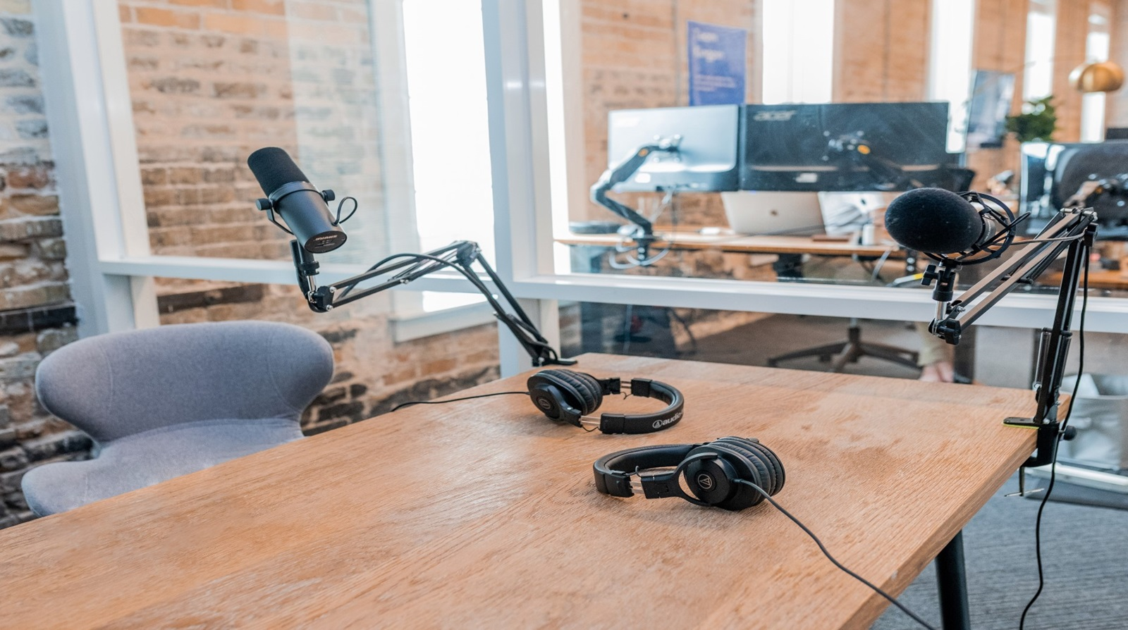 Headphones on a table in a newsroom