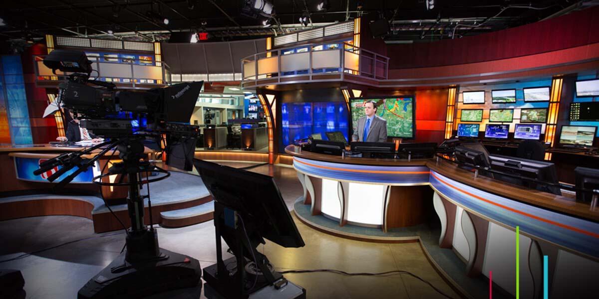 News anchor using Maestro News graphics in studio