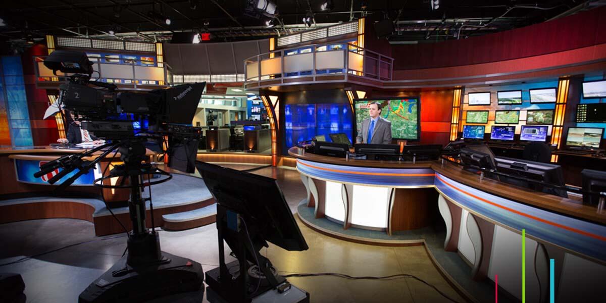 News anchor using Maestro News graphics in studio