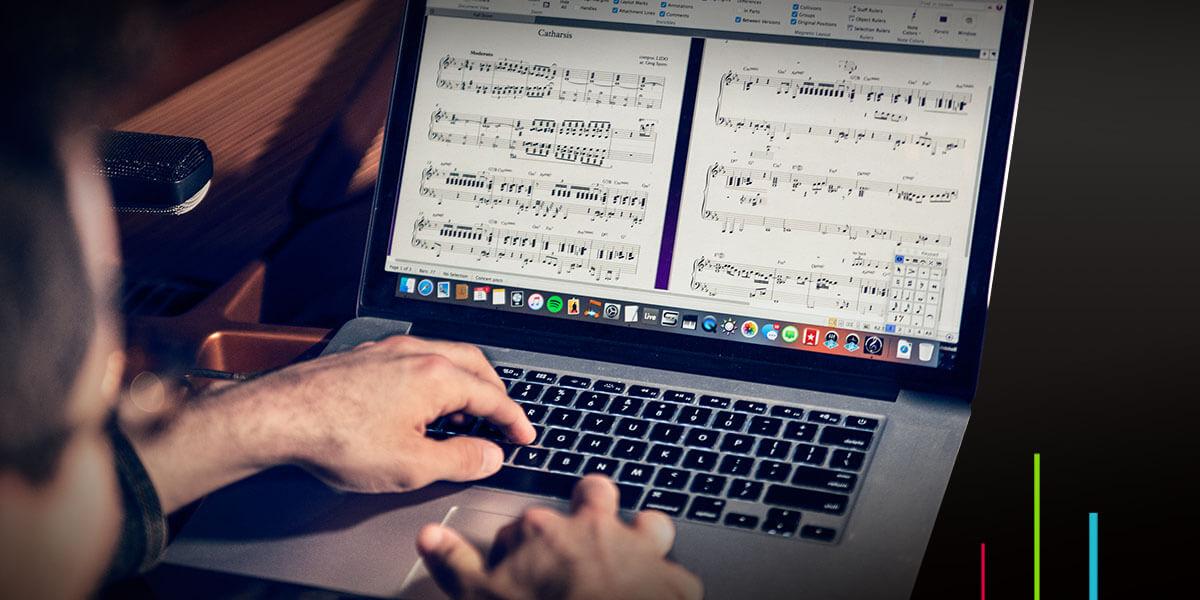 Sibelius music notation software on a laptop editing sheet music